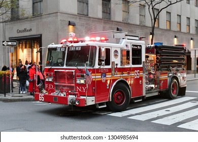 New York City, USA - Nov 16, 2017: A fire engine drives along a street in Manhattan.