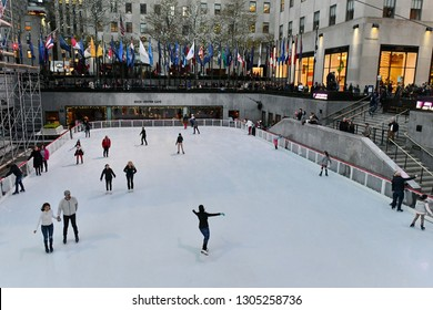 New York City, USA - Nov 16, 2017: People skate at ice rink at the Rockefeller Center.