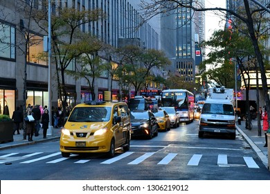 New York City, USA - Nov 16, 2017: Traffic pass along a busy midtown Manhattan street.