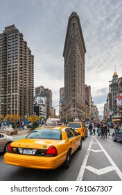 New York City, USA - Nov 13, 2011: Taxis in a street with the flatiron building in the background.