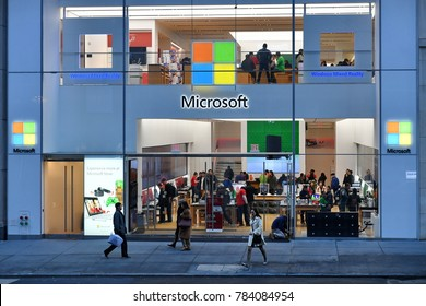 New York City, USA - Nov 16, 2017: People walk past a Microsoft store in Manhattan. Microsoft is world's largest software maker dominant in PC operating systems, office apps and web browser market.