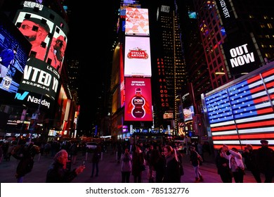 New York City, USA - Nov 16, 2017: Crowd of people walk through the landmark Times Square in midtown Manhattan. Times Square is one of America's major commercial, entertainment and tourist attraction.