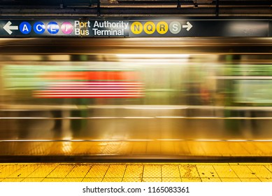 NEW YORK CITY, USA - NOVEMBER 18, 2014 : An empty track of New York City subway station when train passes by in motion blur.