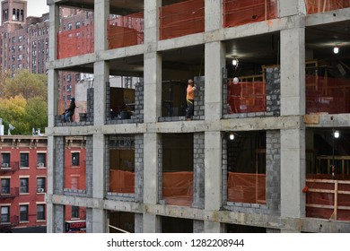 New York City, USA - November 12, 2018: Labourers work on a high rise construction site in Manhattan.