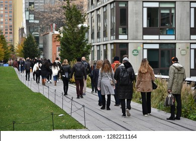 New York City, USA - November 12, 2018: People enjoy the autumn colours on the High Line in Manhattan. The High Line is a popular elevated park created on a former freight rail line.