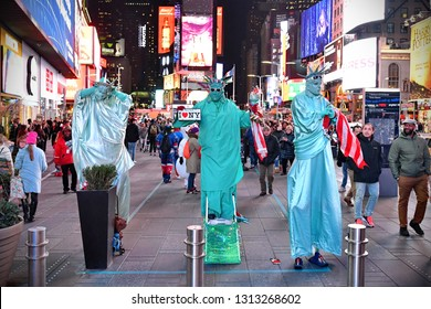 New York City, USA - November 16, 2017: Street performers dressed as the Statue of Liberty busk in the landmark Times Square in midtown Manhattan.