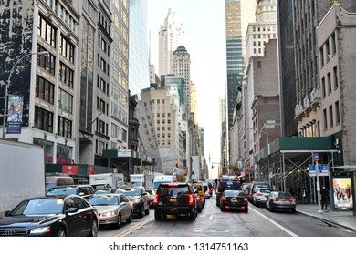 New York City, USA - November 16, 2017: Traffic passes along a busy downtown Manhattan street.