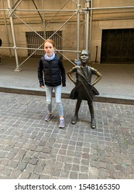 New York City, New York / USA - November 1 2019 : Fearless girl against New York Stock Exchange. Fearless Girl is a bronze sculpture by Kristen Visbal, commissioned by State Street Global.