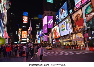 New York City, USA - November 12, 2018: Crowds of people walk through the landmark Times Square in Manhattan. The area is one of America's major commercial, entertainment and tourist attractions.