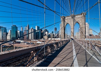 NEW YORK CITY, USA - NOVEMBER 18: People crossing Brooklyn bridge in New York City at November 18, 2011, the oldest suspension bridges in the United States.