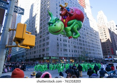 NEW YORK CITY, USA- NOVEMBER 23 2017: the 91st annual Macy's Thanksgiving Day parade attracted hundreds of thousands of spectators. The Grinch Who Stole Christmas Balloon