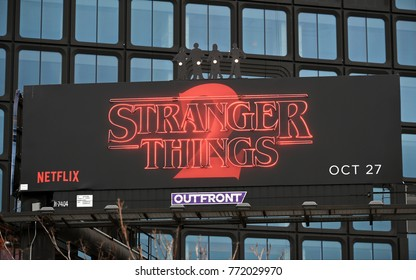 New York City, USA - November 7, 2017: View of a neon Stranger Things 2 billboard sign seen above a Manhattan street.