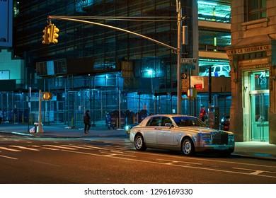 New York City, USA: Oct 14 2017 - Rolls-Royce Phantom VII, a full-sized luxury saloon sedan car released circa 2015 in England parked on the night street.