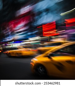 NEW YORK CITY, USA - OCT 11, 2014: Illumination and night lights on The Times Square at night in New York City. Times Square is major commercial intersection in New york. Image in motion blur style.
