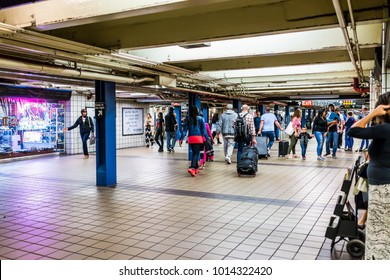 New York City, USA - October 28, 2017: People walking in underground transit by sign in NYC Subway Station, exit sign Port Authority Bus Terminal, by midtown Times Square