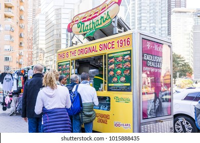 New York City, USA - October 28, 2017: Columbus Circle in Midtown Manhattan NYC, Nathan's Hot Dog Food Truck stand with sign, menu, line queue of people customers