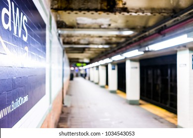 New York City, USA - October 30, 2017: Amazon Web Services AWS advertisement ad sign closeup in underground transit platform in NYC Subway Station, wall tiled, arrow, side