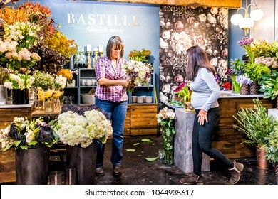 New York City, USA - October 30, 2017: Market food shop florist flowers Bastille in downtown lower Chelsea neighborhood district Manhattan NYC, people bouquets decorations