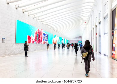 New York City, USA - October 30, 2017: People in The Oculus transportation hub at World Trade Center NYC Subway Station, commute, walking at transfer path hall, Naked Juice