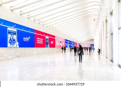 New York City, USA - October 30, 2017: People in The Oculus transportation hub at World Trade Center NYC Subway Station, commute, walking at transfer path hall, Amazon audible
