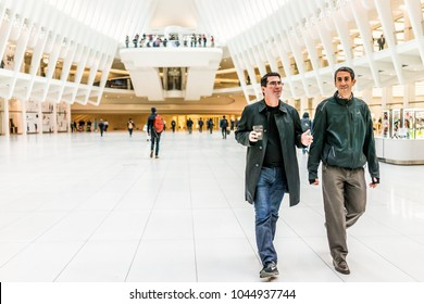 New York City, USA - October 30, 2017: People in The Oculus transportation hub at World Trade Center NYC Subway Station, commute, walking on hall floor