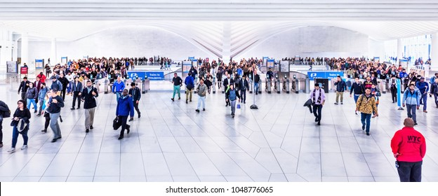 New York City, USA - October 30, 2017: People in The Oculus transportation hub at World Trade Center NYC Subway Station, commute, New Jersey PATH train, many crowded crowd exit machines