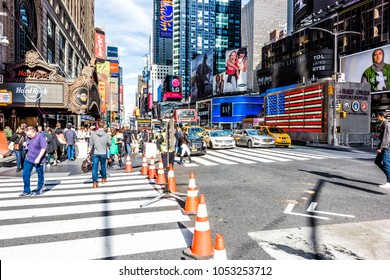 New York City, USA - October 28, 2017: Manhattan NYC buildings of midtown Times Square, Broadway avenue road, signs ads, Hard Rock cafe, crowd of people crowded walking on street outside