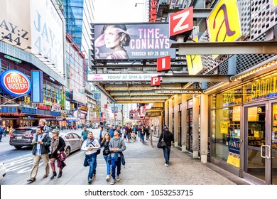 New York City, USA - October 28, 2017: Manhattan NYC buildings of midtown Times Square, Broadway avenue road, signs for Dave and Busters, Theater