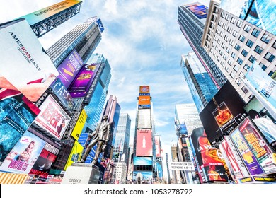 New York City, USA - October 28, 2017: Manhattan NYC buildings of midtown Times Square, Broadway avenue road, Duffy Square with many crowd people, skyscrapers looking up