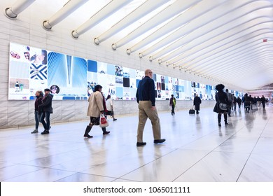 New York City, USA - October 30, 2017: People in The Oculus transportation hub at World Trade Center NYC Subway Station, commute, walking at transfer path hall
