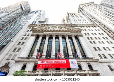 New York City, USA - October 30, 2017: Wall street, NYSE stock exchange building entrance in NYC Manhattan lower financial district downtown, column architecture, American flags