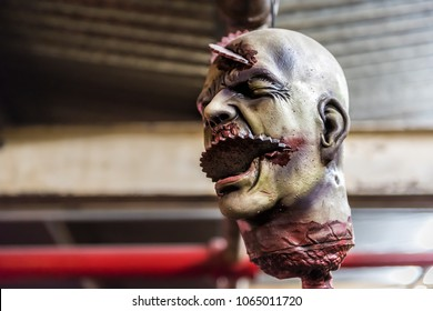 New York City, USA - October 30, 2017: Market food shop interior inside in downtown lower Chelsea neighborhood district Manhattan NYC, closeup of hanging scary spooky severed head Halloween decoration