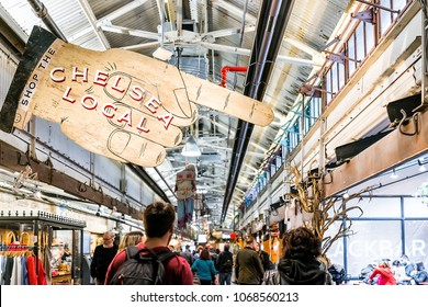 New York City, USA - October 30, 2017: Market food shop interior inside in downtown lower Chelsea neighborhood district Manhattan NYC, people walking by sign