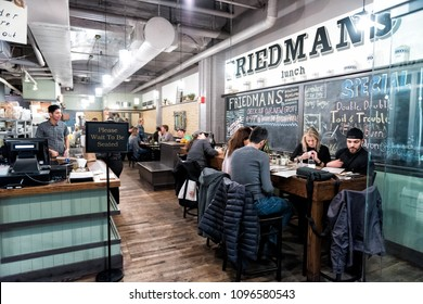 New York City, USA - October 30, 2017: Market food in Chelsea neighborhood district Manhattan NYC, people eating in cafe restaurant called Friedman's lunch