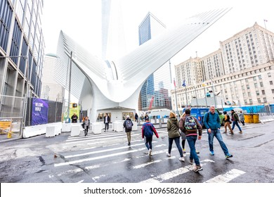New York City, USA - October 30, 2017: People entering doors at the Oculus transportation hub at World Trade Center NYC Subway Station, modern futuristic white construction, exterior building entrance