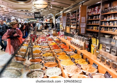 New York City, USA - October 30, 2017: Market food shop in Grand Central Manhattan NYC, many spices on display in bowls trays filled with herbs, signs, curry, turmeric, mixes in store bazaar