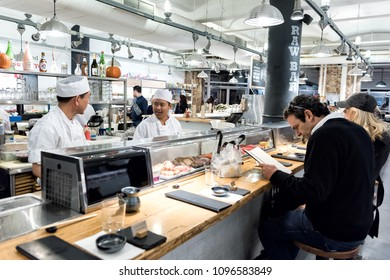 New York City, USA - October 30, 2017: Market food Lobster place shop in Chelsea neighborhood district Manhattan NYC, Sushi Chefs preparing food, people sitting at bar counter