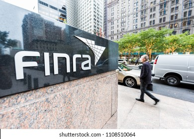 New York City, USA - October 30, 2017: Sign on the building of Financial Industry Regulatory Authority, or Finra, in Manhattan NYC lower financial district downtown, businessman man walking