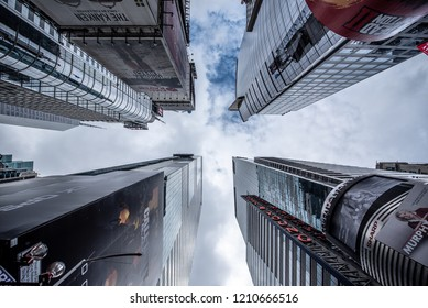 NEW YORK CITY, USA - OCTOBER 16, 2018: A view looking up at skyscrapers in Times Square, located in Midtown Manhattan, New York City.