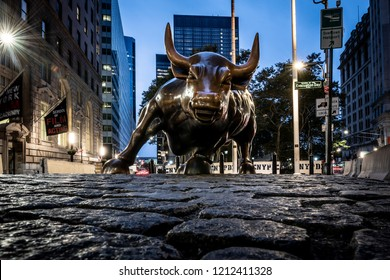 NEW YORK CITY, USA - OCTOBER 11, 2018: A view of the Charging Bull statue at dawn, located in lower Manhattan on Wall Street