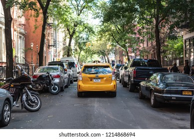 NEW YORK CITY, USA - OCTOBER 12, 2018: A New York Yellow Taxi driving down a street in Manhattan, NYC.