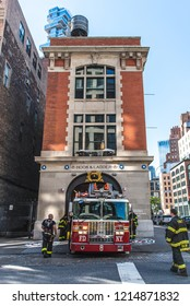 NEW YORK CITY, USA - OCTOBER 12, 2018: FDNY reversing firetruck into the Hook & Ladder 8 Firehouse. The firehouse was made famous in the film Ghostbusters. Located in Tribeca, lower Manhattan.