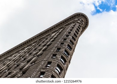 New York City, USA - October 10, 2015: Flatiron Building. Cloudy day with a little blue. Point of view.