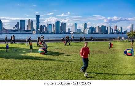 NEW YORK CITY, USA - OCTOBER 18, 2018 : Unknown children playing at  Hudson River Park in New York, USA.