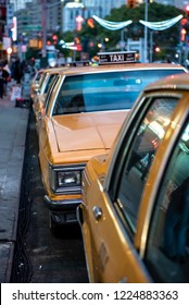 NEW YORK CITY, USA - OCTOBER 17, 2018: Old style New York yellow taxi cabs lined up on the streets on Manhattan, NYC.