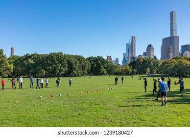 NEW YORK CITY, USA - OCTOBER 18, 2018 : Unidentified young  people plays with balls in Central Park, New York, USA.