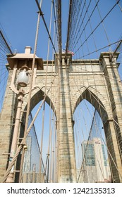 New York City, USA - October 4, 2018: View on Brooklyn bridge and on skycrapers behind in New York City during sunny day in autumn 2018