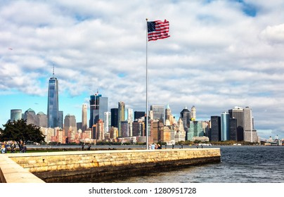 NEW YORK CITY, USA - OCTOBER 4, 2016: New York panorama, One World Trade Center (formerly known as the Freedom Tower) and Ellis Island. Freedom Tower is shown finished with antenna.
