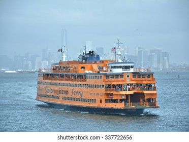 NEW YORK CITY, USA - OCTOBER 15, 2014: Staten Island Ferry departs for Manhattan. The ferry carries over 21 million passengers a year