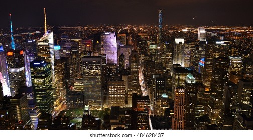 New York City, USA - October 13, 2015: Aerial view of the Times Square district in midtown Manhattan at night, centered on the Bank of America Tower.